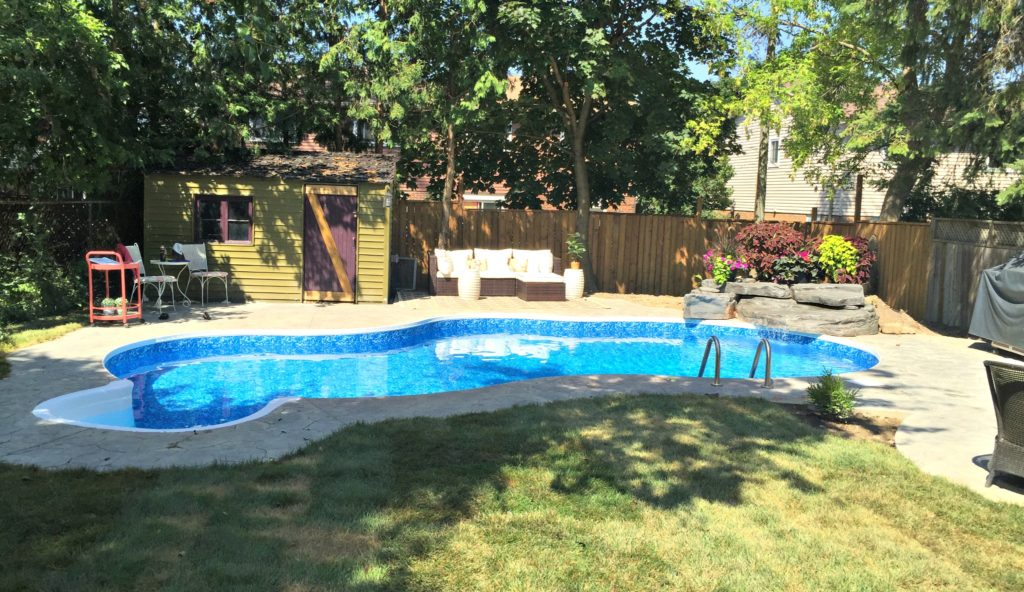 Summer Home Tour. Check out tips and tricks on changing out your decor for the summer. Featuring an outdoor pool waterfall at apurdylittlehouse.com